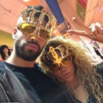 Gerard Pique pose for a photo with his partner Shakira